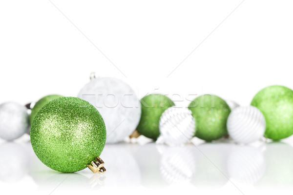 Green and silver christmas baubles Stock photo © karandaev