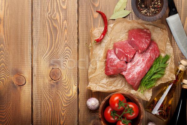 Ruw filet biefstuk specerijen houten tafel top Stockfoto © karandaev