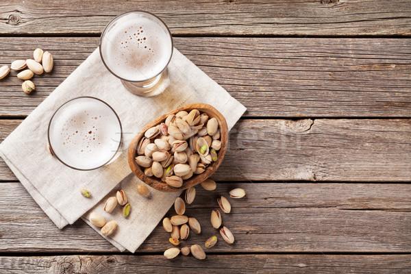 Lager beer glasses and snacks Stock photo © karandaev