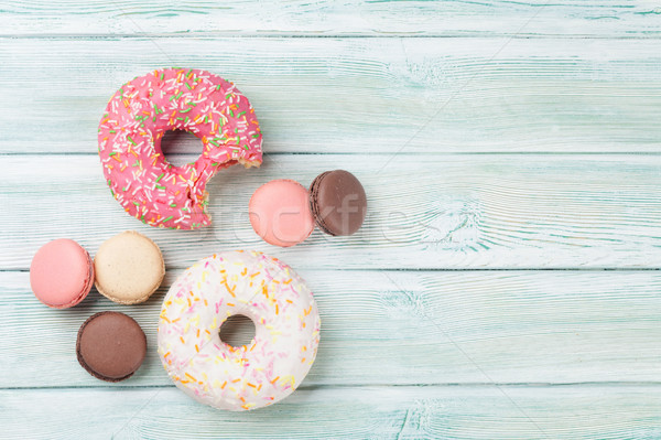 Colorful donuts and macaroons Stock photo © karandaev