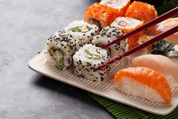 Sushi maki set pietra tavola alimentare Foto d'archivio © karandaev