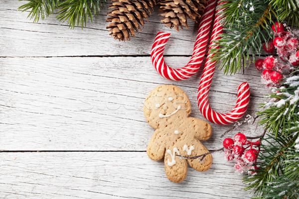 Christmas tree, candy cane and gingerbread man Stock photo © karandaev