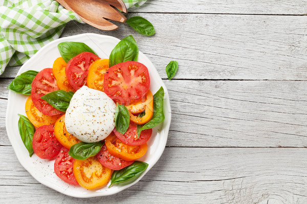 Stock photo: Caprese salad with tomatoes, basil and mozzarella