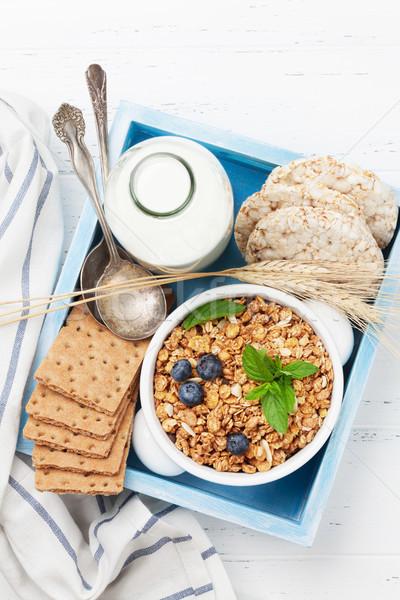 Healthy breakfast set with muesli, berries and milk Stock photo © karandaev