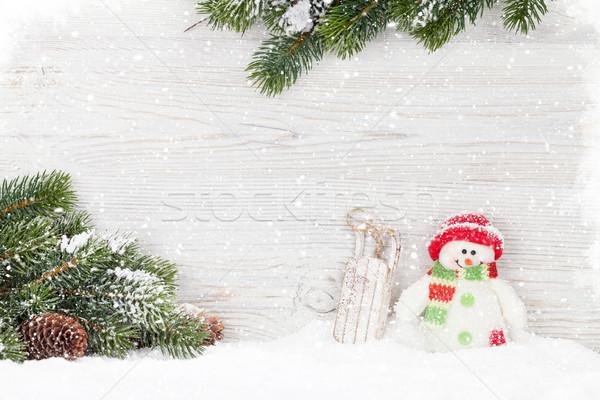 Christmas snowman and sledge toys and fir tree branch Stock photo © karandaev
