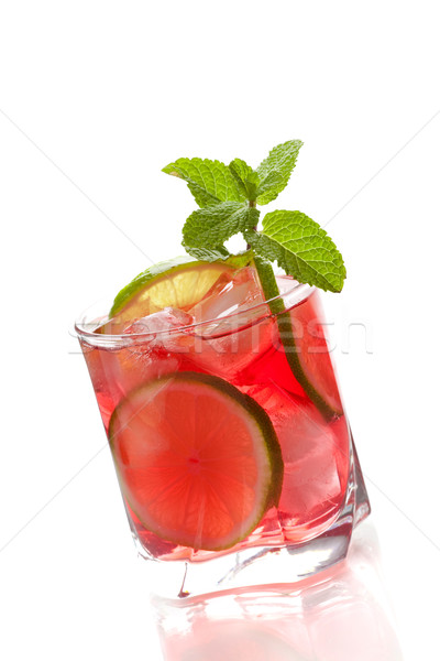 Stock photo: Red alcohol cocktail with lime slices and mint