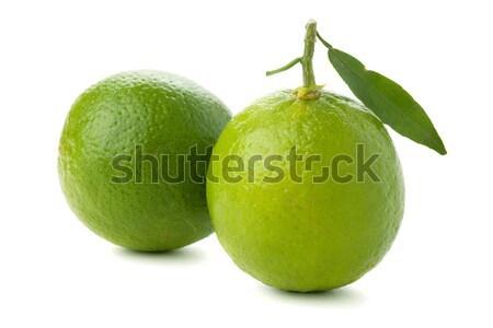 Three ripe limes with green leaf Stock photo © karandaev