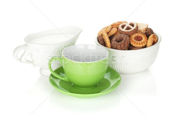 Various cookies, milk and tea cup Stock photo © karandaev