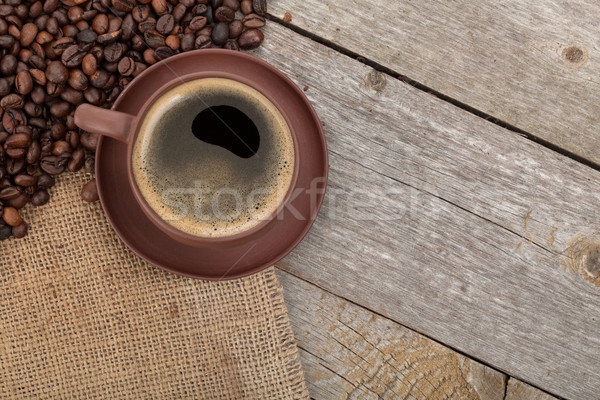 Coffee cup and beans on wooden table Stock photo © karandaev