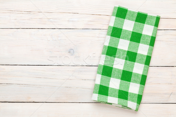 Green towel over wooden kitchen table Stock photo © karandaev