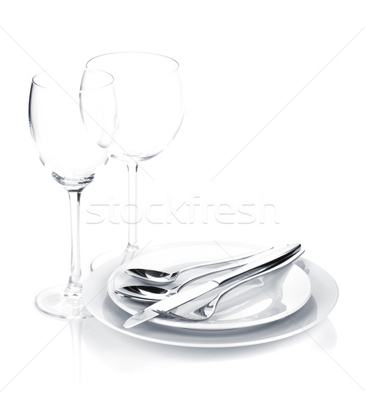 Silverware or flatware set over plates and wine glasses Stock photo © karandaev