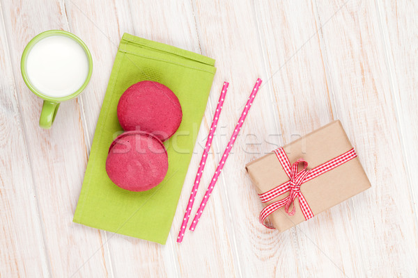 Colorful macarons, cup of milk and gift box Stock photo © karandaev