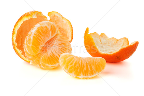 Ripe tangerines segments and rind Stock photo © karandaev