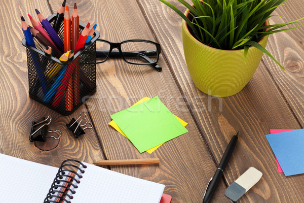 Office table with flower, blank notepad and supplies Stock photo © karandaev
