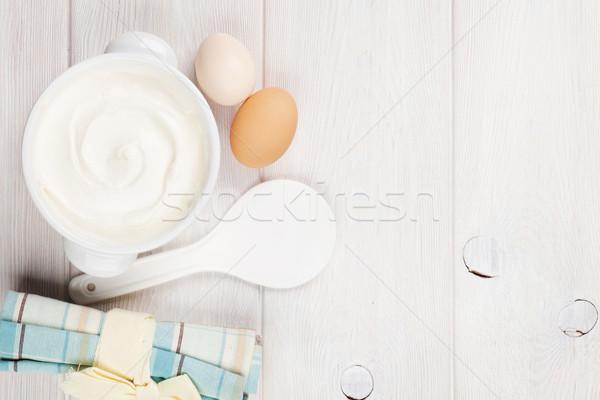 Tejföl tál tojások fa asztal felső kilátás Stock fotó © karandaev