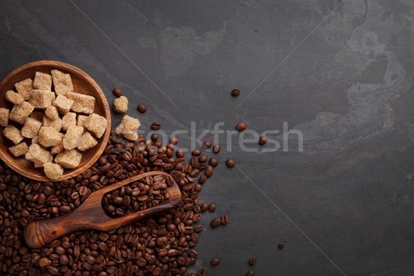 Kahve çekirdekleri esmer şeker taş tablo üst görmek Stok fotoğraf © karandaev