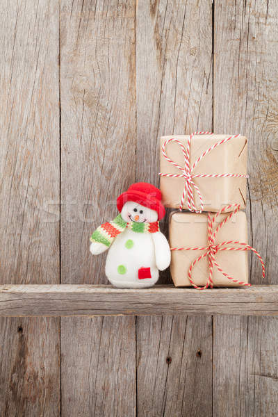 Christmas gift boxes and snowman toy Stock photo © karandaev