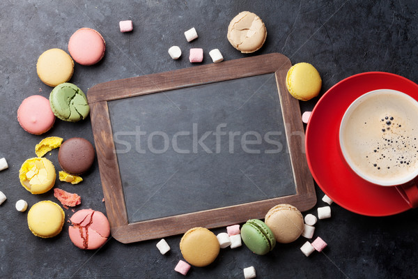 Colorful macaroons, coffee and blackboard Stock photo © karandaev