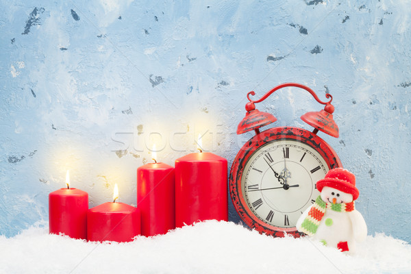 Christmas candles, snowman toy and alarm clock Stock photo © karandaev