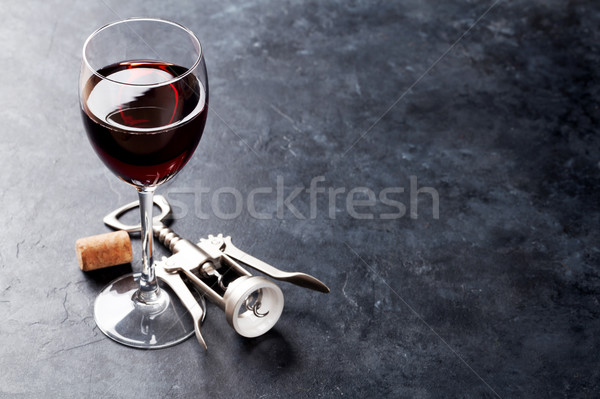 Red wine glass and corkscrew Stock photo © karandaev