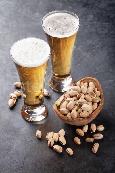 Lager beer and nuts Stock photo © karandaev