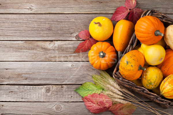 Autumn pumpkins on wooden table Stock photo © karandaev