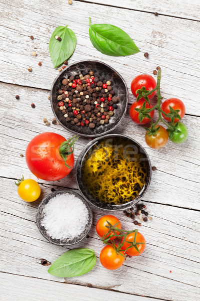 Tomatoes, basil and spices Stock photo © karandaev