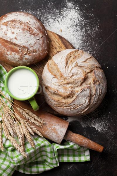 Various crusty bread and cup of milk Stock photo © karandaev