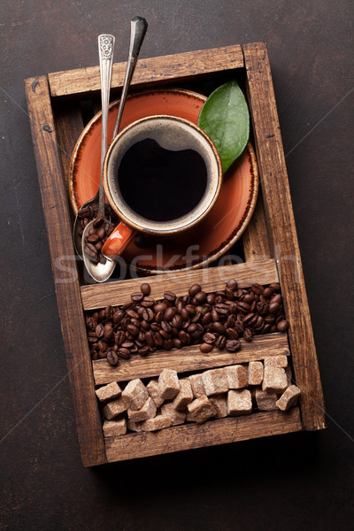 Coffee cup, roasted beans and brown sugar Stock photo © karandaev