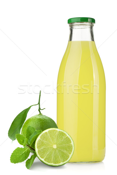 Stock photo: Lime juice bottle, ripe limes and mint
