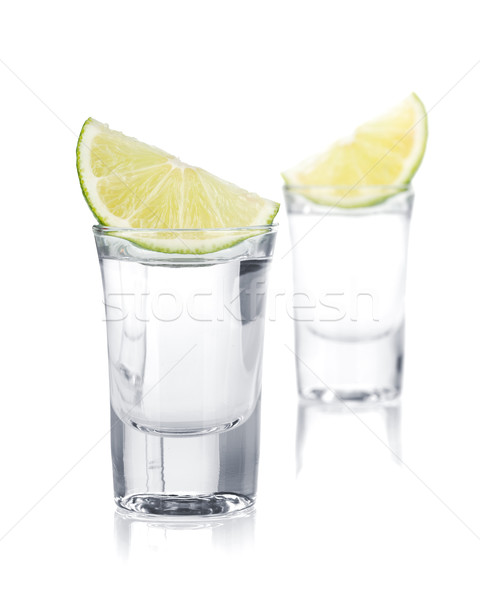 Two shots of vodka and lime slice Stock photo © karandaev