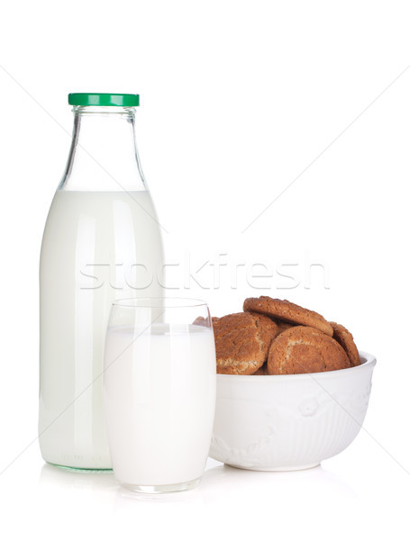 Glass, bottle of milk and cookies bowl Stock photo © karandaev