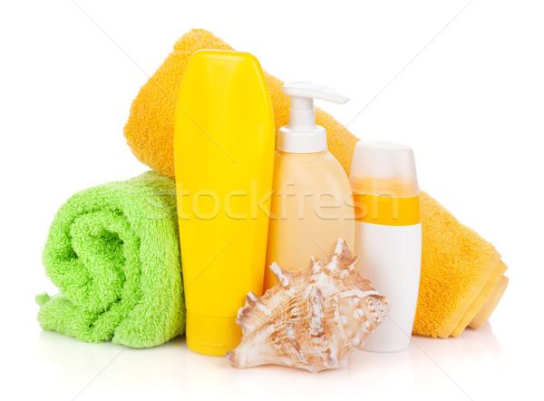 Bath bottles, towel and seashell Stock photo © karandaev