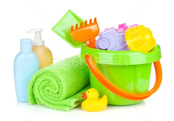 Beach baby toys, towel and bottles Stock photo © karandaev