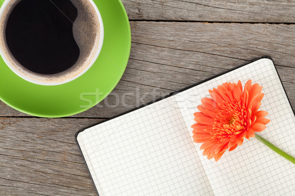 Blank notepad, coffee cup and orange gerbera flower Stock photo © karandaev