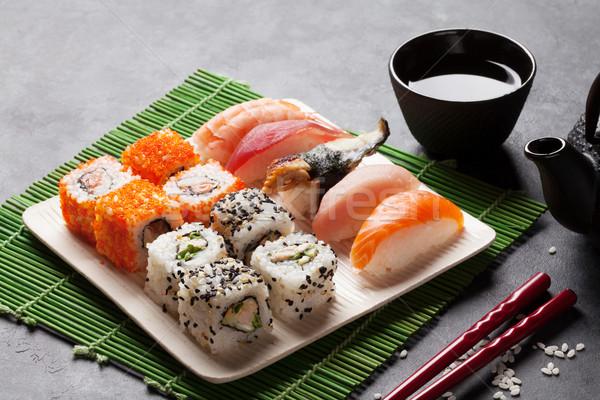 Zestaw sushi maki zielona herbata kamień tabeli Zdjęcia stock © karandaev