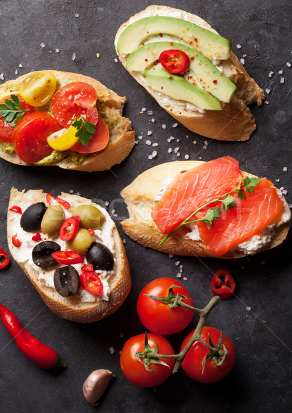 Toast sandwiches with avocado, tomatoes, salmon Stock photo © karandaev