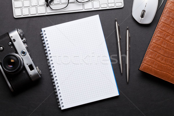 Office desk with camera, pc, notepad Stock photo © karandaev