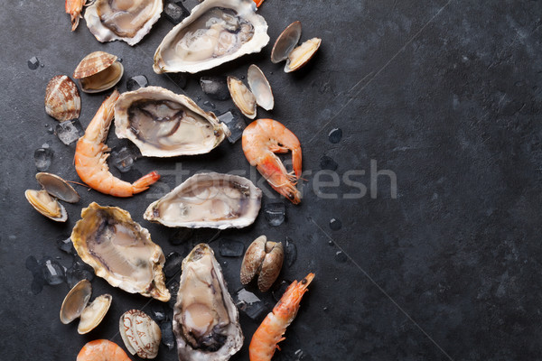 Fresh seafood on stone table Stock photo © karandaev