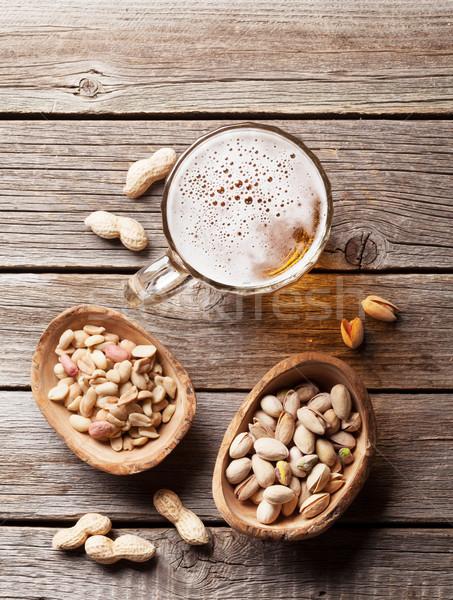 Piwo jasne pełne piwa kubek przekąski drewniany stół górę Zdjęcia stock © karandaev
