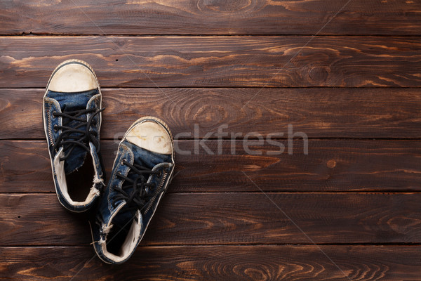 Sneakers on wooden background Stock photo © karandaev
