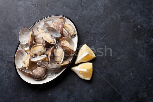 Fresh seafood bowl on stone table. Scallops Stock photo © karandaev