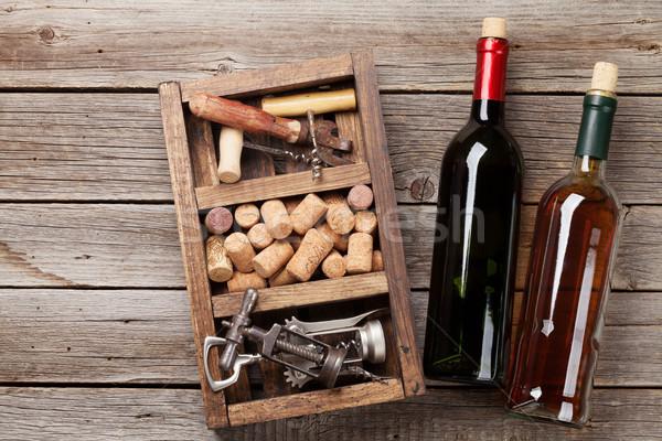 Wine bottles, corkscrew and corks Stock photo © karandaev