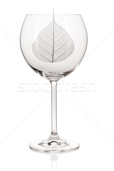 Transparent leaf in a wine glass Stock photo © karandaev