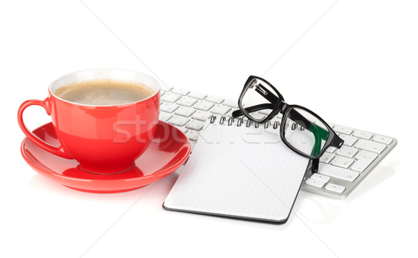 Red coffee cup, glasses and office supplies Stock photo © karandaev