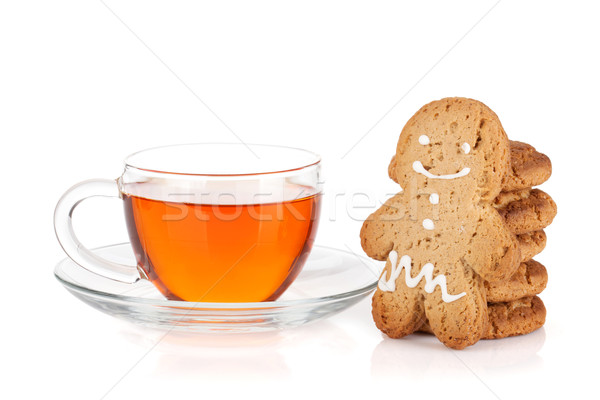 Glass cup of black tea with homemade cookies and gingerbread man Stock photo © karandaev