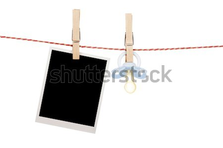 Blank photo hanging on clothesline Stock photo © karandaev