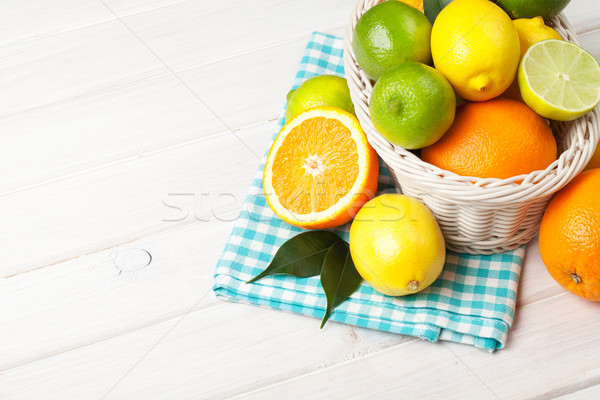 Stock photo: Citrus fruits in basket. Oranges, limes and lemons