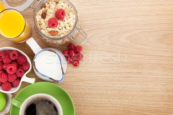 Stock photo: Healty breakfast with muesli, berries, orange juice, coffee and