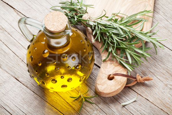 Stock photo: Fresh garden rosemary and olive oil